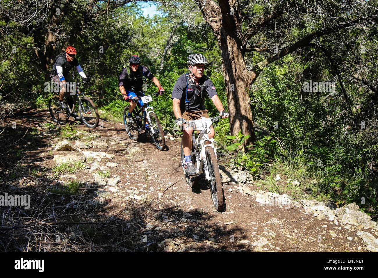 Former US President George W. Bush (right) leads military service members on the W100K mountain bike ride across - Stock Image