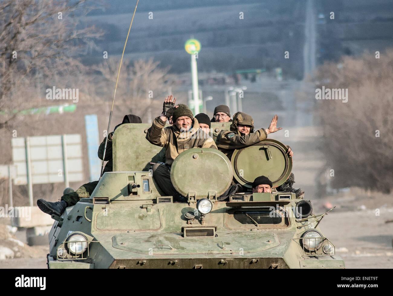 Pro-russian separatist rebels wave to people in the eastern Ukraine town of Debaltseve - Stock Image