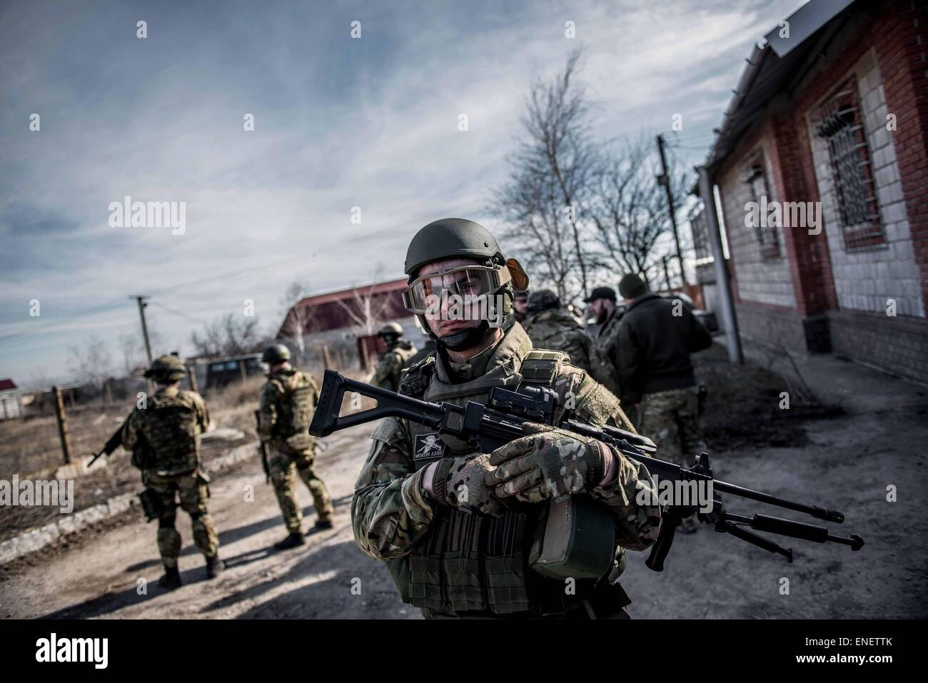 A fighter from the Azov Battalion near the front line in eastern Ukraine. - Stock Image