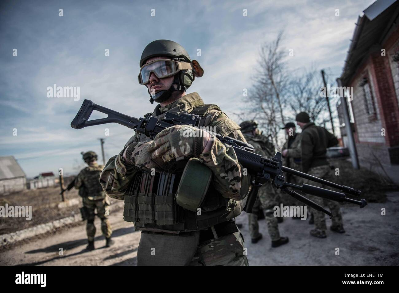 A fighter from the azov battalion stands near the front line in Eastern Ukraine. - Stock Image