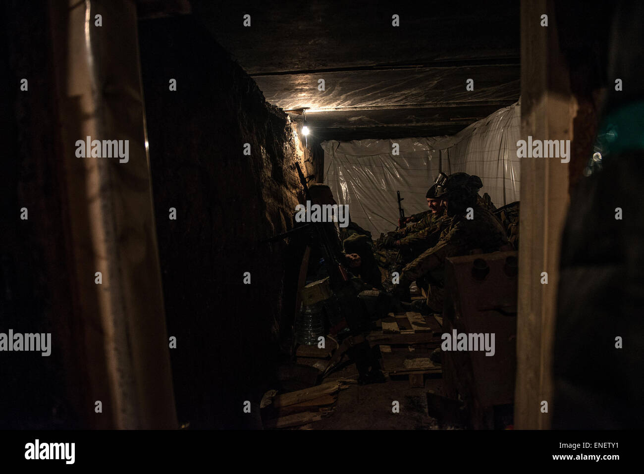 March 15 2015 - Mariupol, Ukraine: Volunteer fighters take cover in the trenches outside Shyrokine. Despite a ceasfire - Stock Image