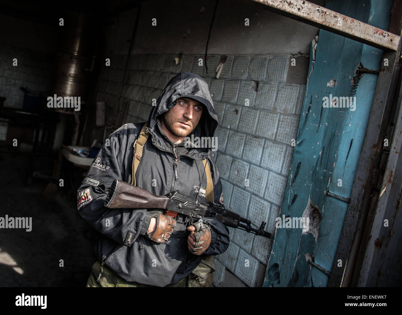 A separatist rebel fighter stands guard on the front line in the ruins fo Donetsk airport, eastern ukraine. - Stock Image