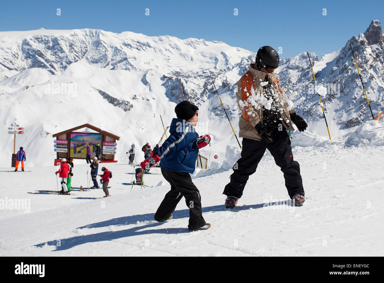 Boy hits man with snowball - Stock Image