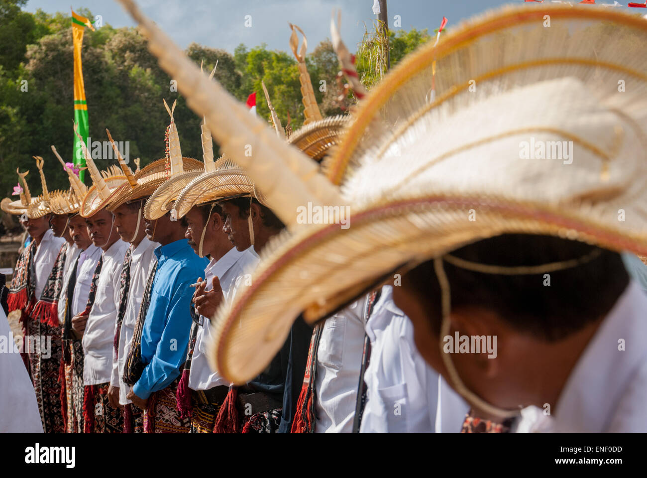Men of Rote Island stand in line as they held traditional ceremony. - Stock Image