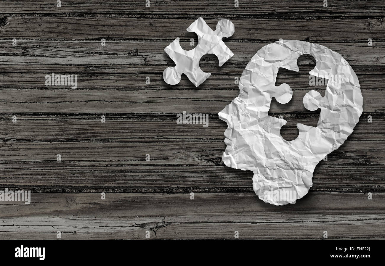 Mental health symbol Puzzle and head brain concept as a human face profile made from crumpled white paper with a - Stock Image