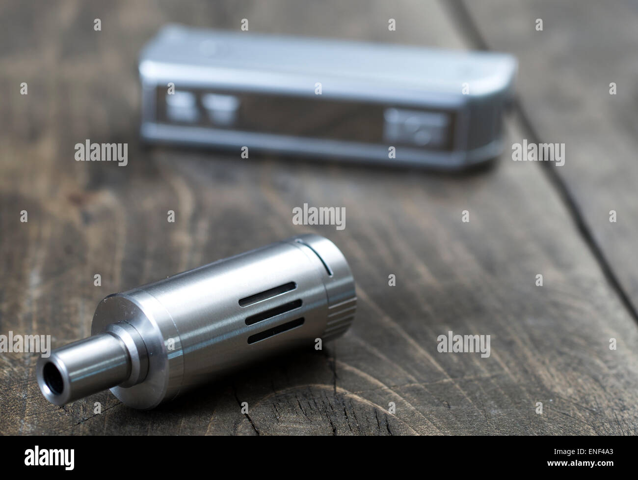 electronic cigarette on old wooden table, close up - Stock Image