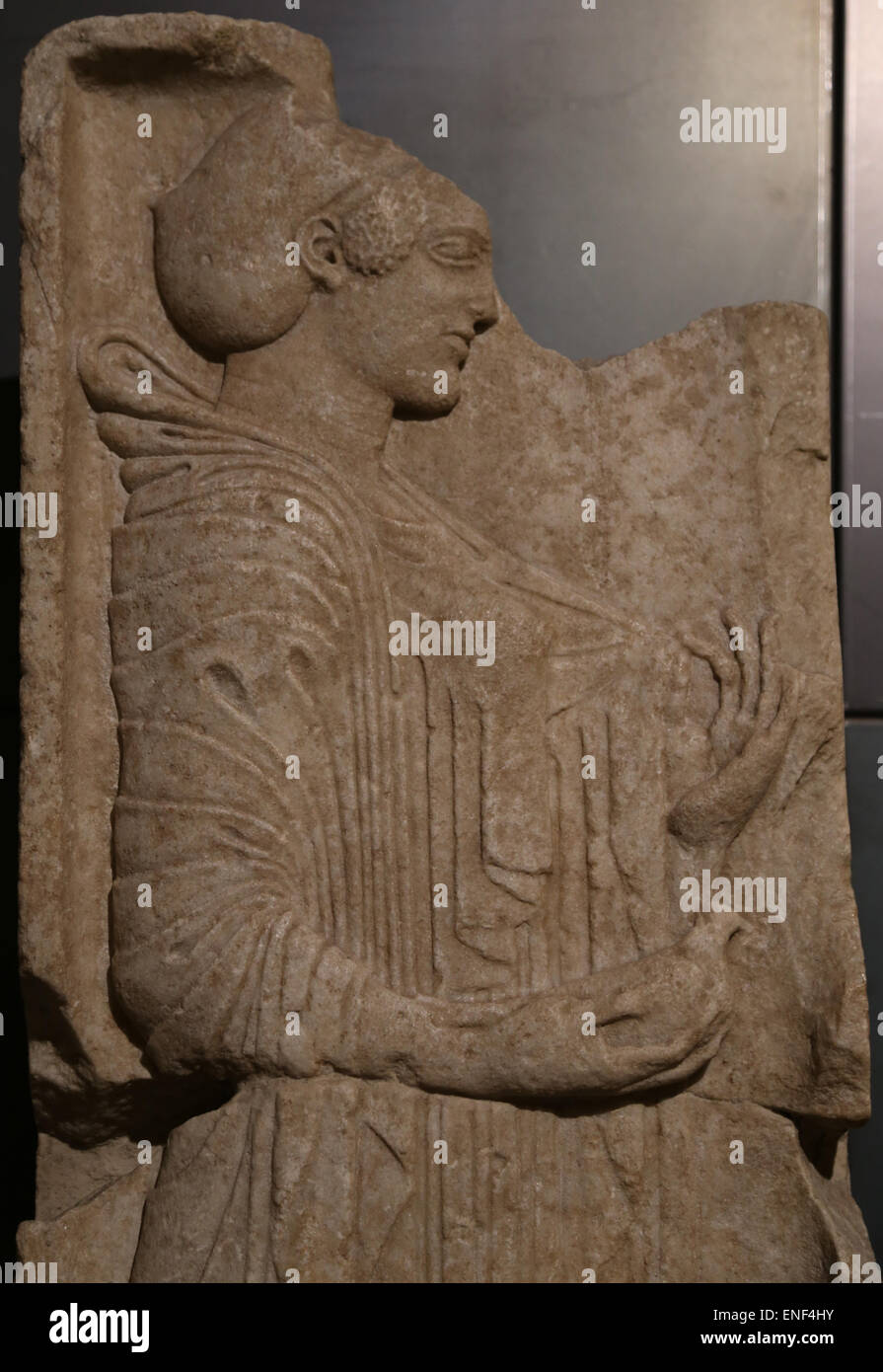 Grave stele. Marble. Greek original of the ionic school. 500-490 BC. Young girl holding a dove in her right hand. - Stock Image