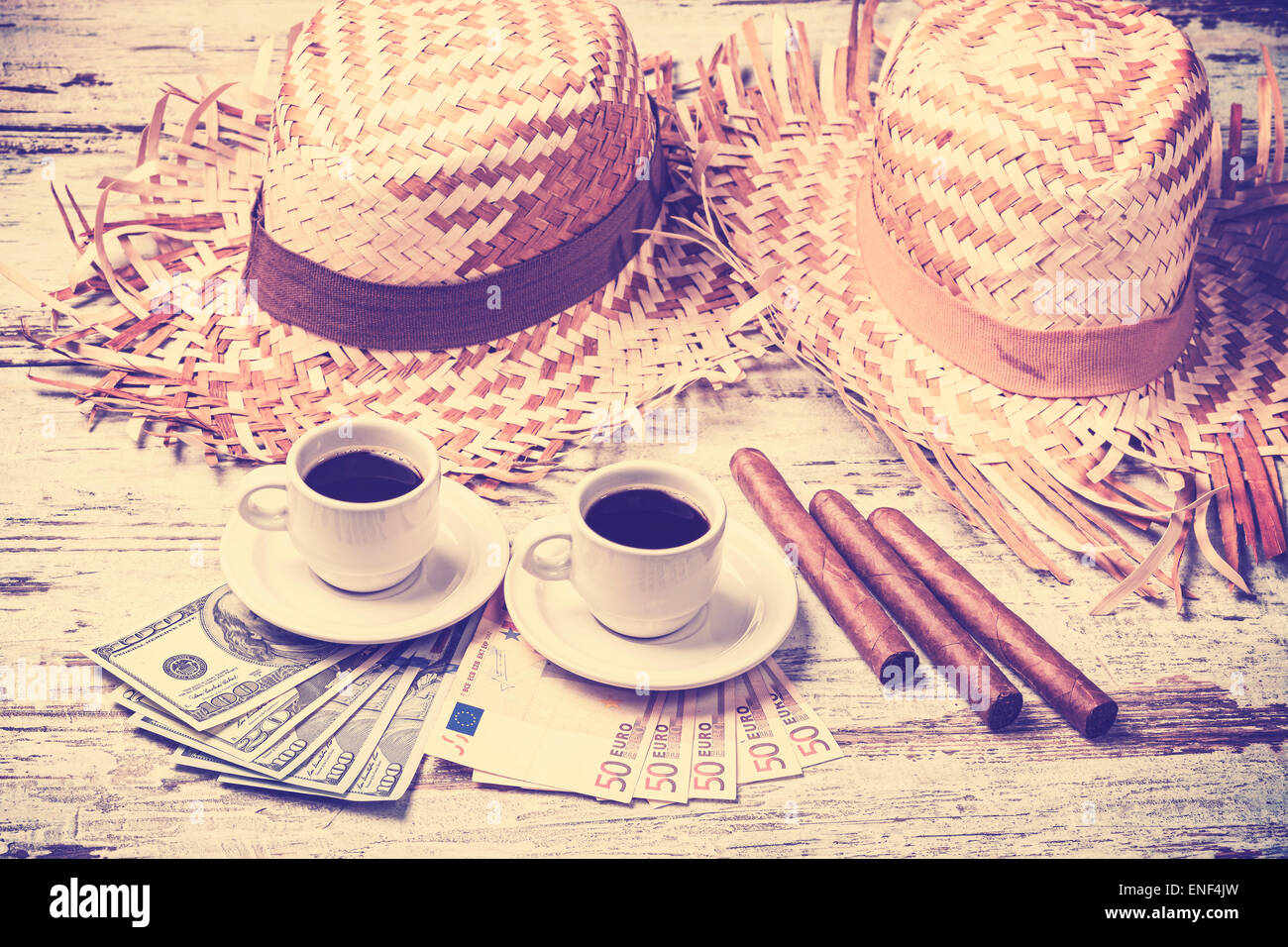 Vintage filtered coffees, cigars, money and hats. Summer adventure concept. - Stock Image