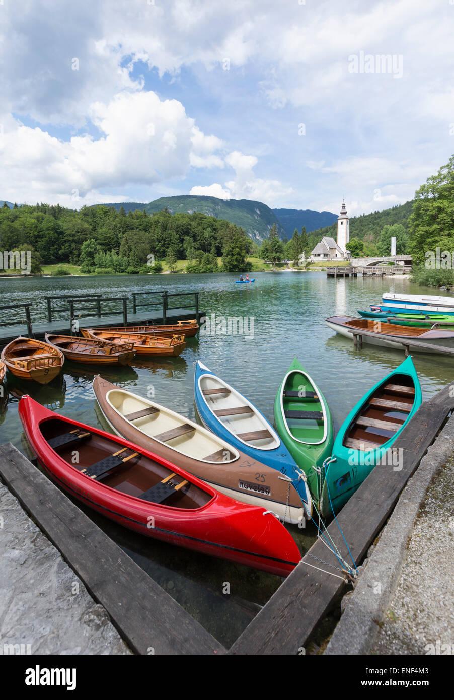 Lake Bohinj (Bohinjsko jezero), Triglav National Park, Upper Carniola, Slovenia.  Canoes for rent.  Ribcev Laz. - Stock Image