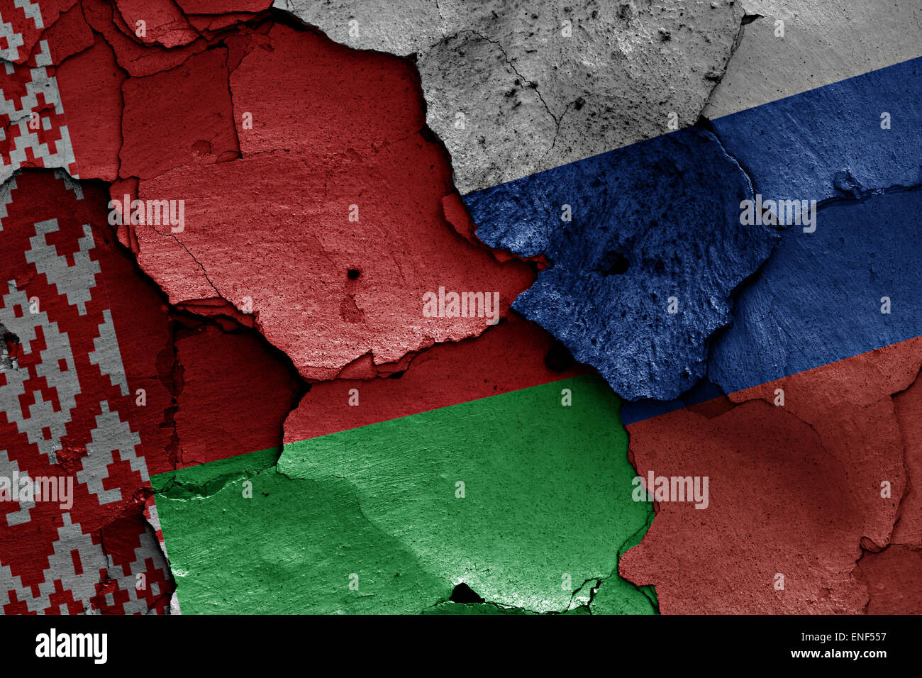 flags of Belarus and Russia painted on cracked wall - Stock Image