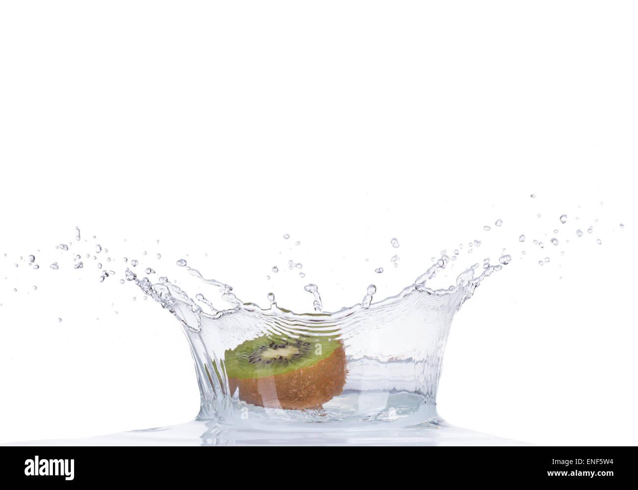 Fresh kiwi in water splash isolated on white backround - Stock Image