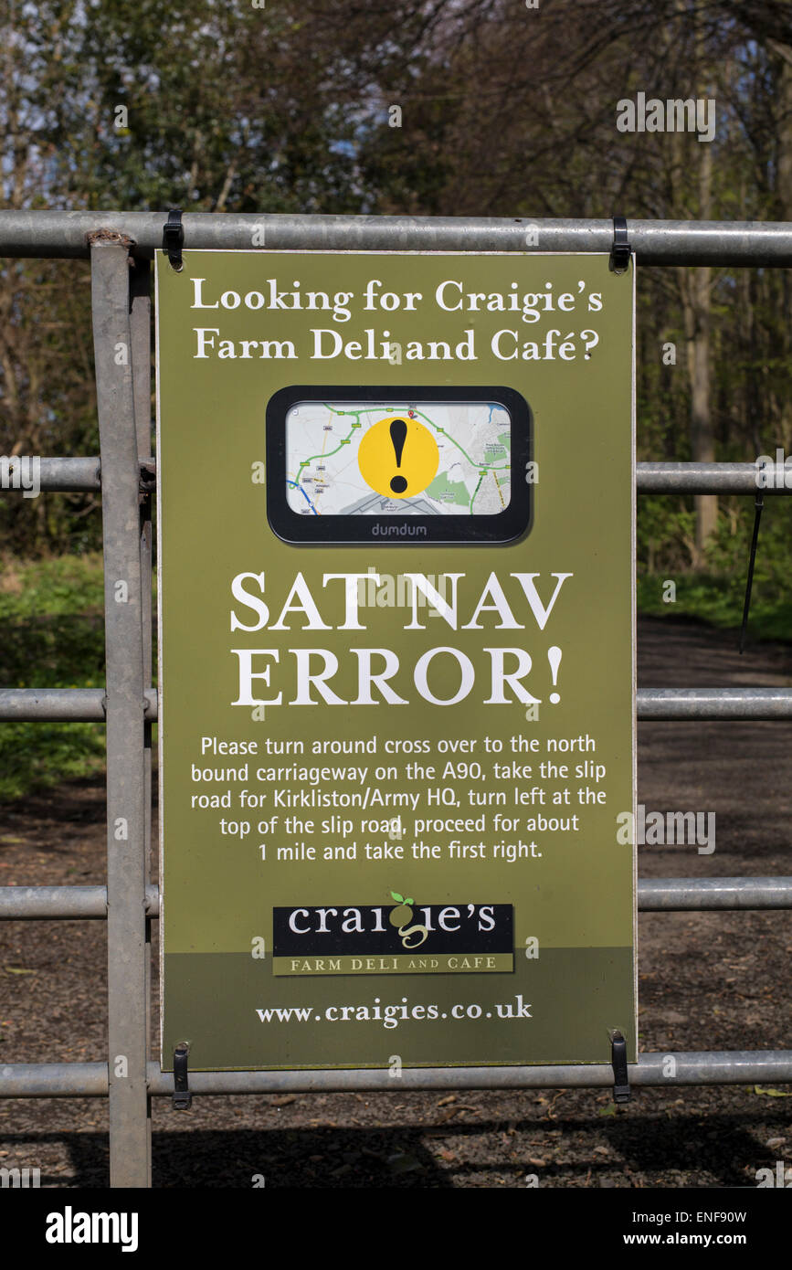 Sign on a gate out in the countryside near Edinburgh highlighting a Sat Nav error. - Stock Image