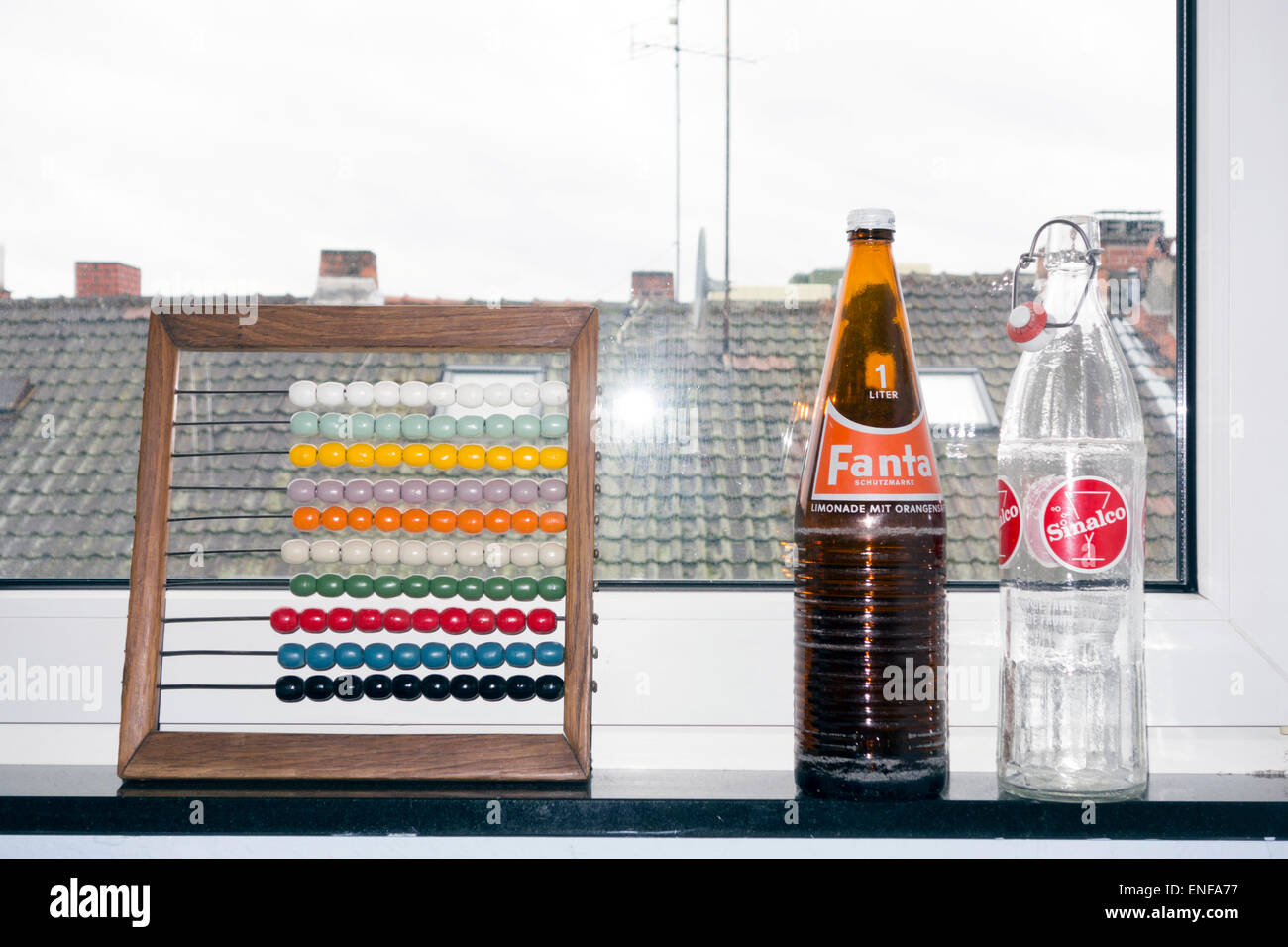 Interior design: Old bottles and an abacus - Stock Image