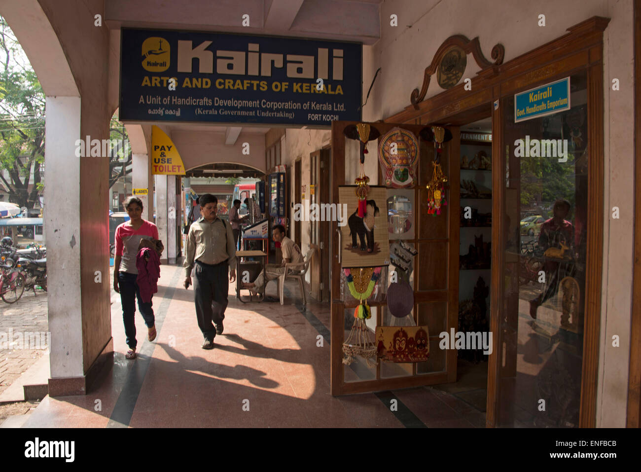 Tourists Approaching A Souvenir Shop Of Arts And Crafts Of Kerala In