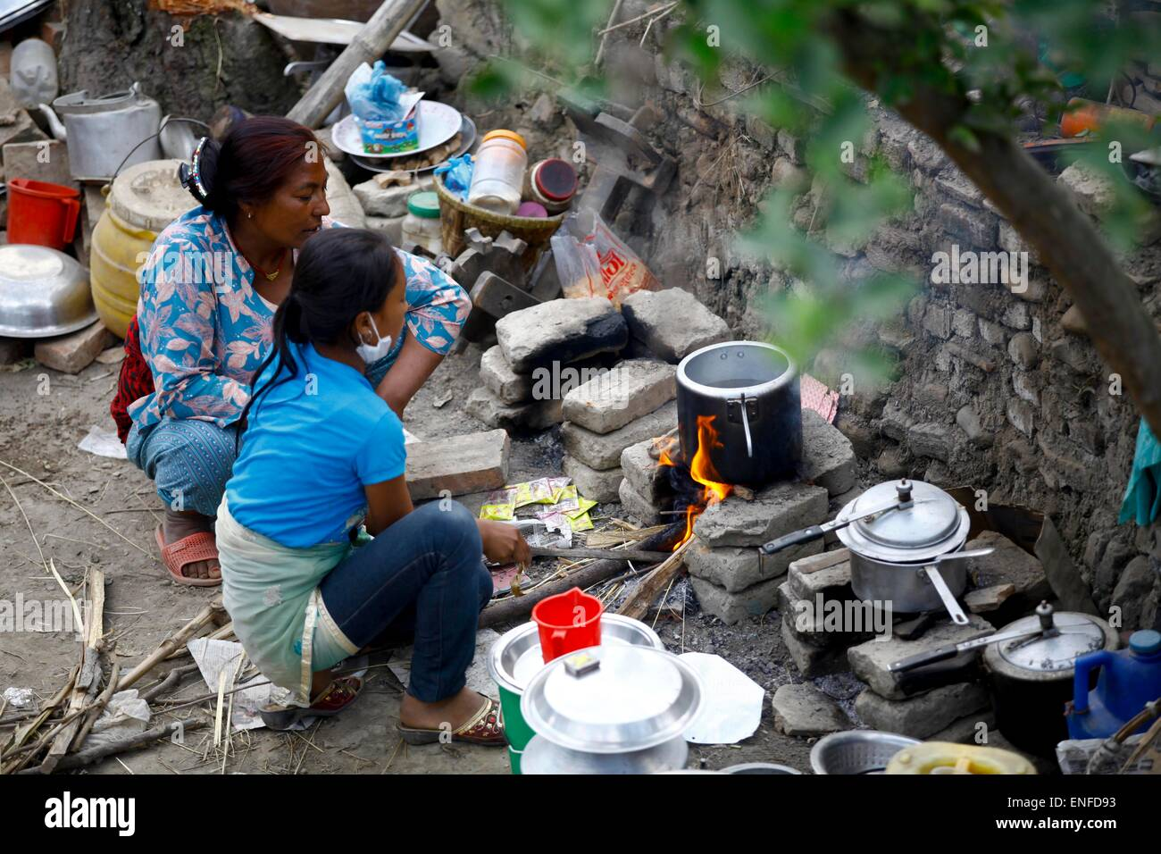 Lalitpur, Nepal  4th May, 2015  People cook food on roadside