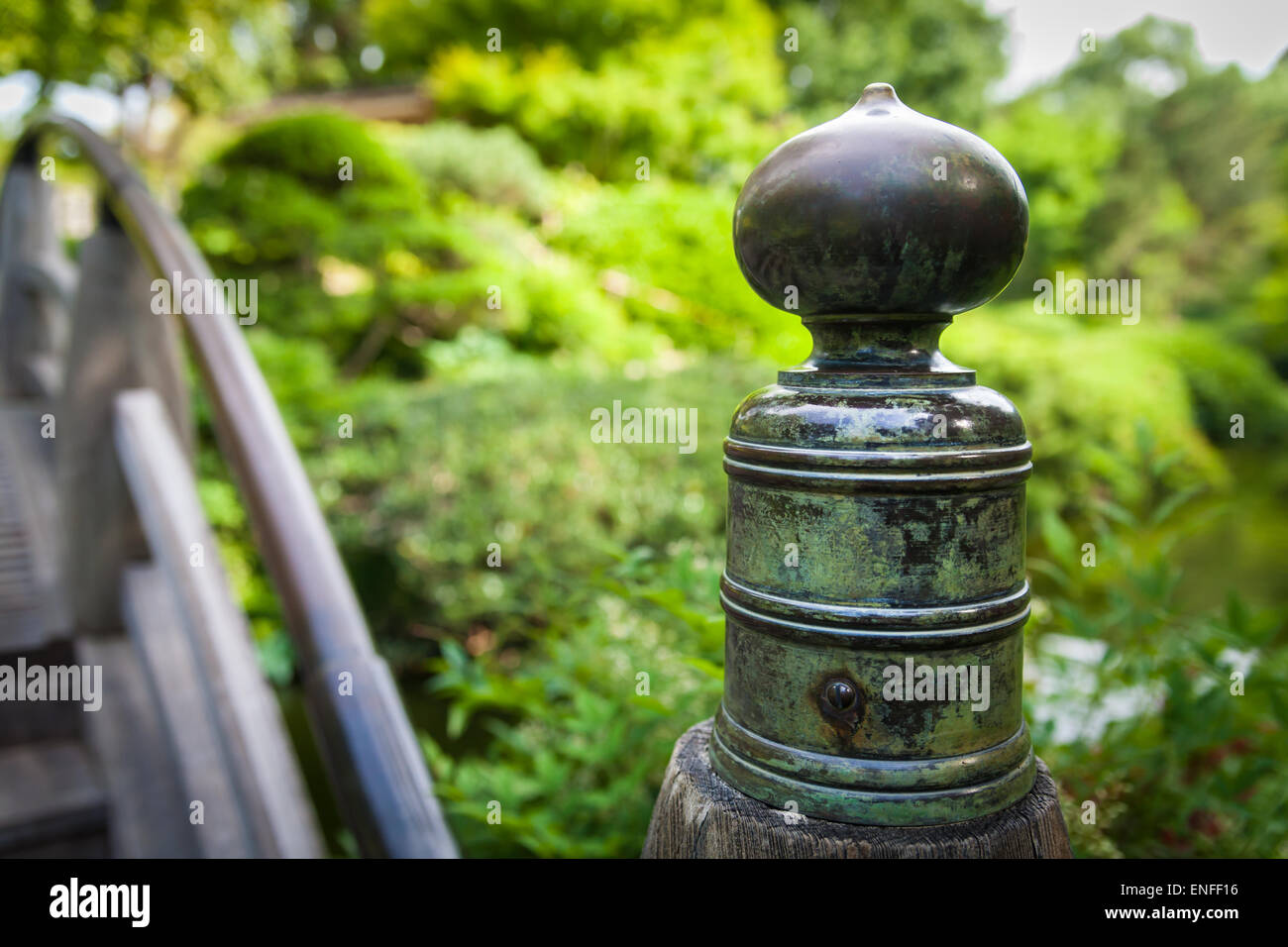 Close up view of a weathered ornamental fixture on a bridge in the Japanese Botanical Gardens in Fort Worth, Texas. - Stock Image