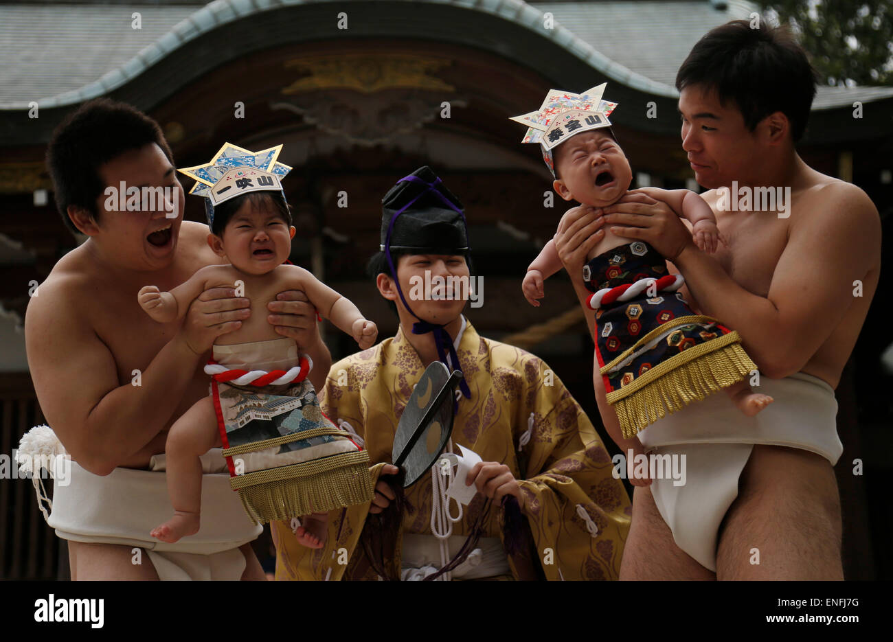 Tokyo, Japan. 5th May, 2015. Babies take part in 'baby-cry sumo' competition at a shrine in Kanagawa prefecture, - Stock Image