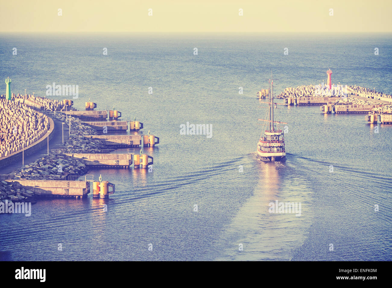 Retro vintage filtered picture of an old sailing ship leaving port in Kolobrzeg, Poland. - Stock Image