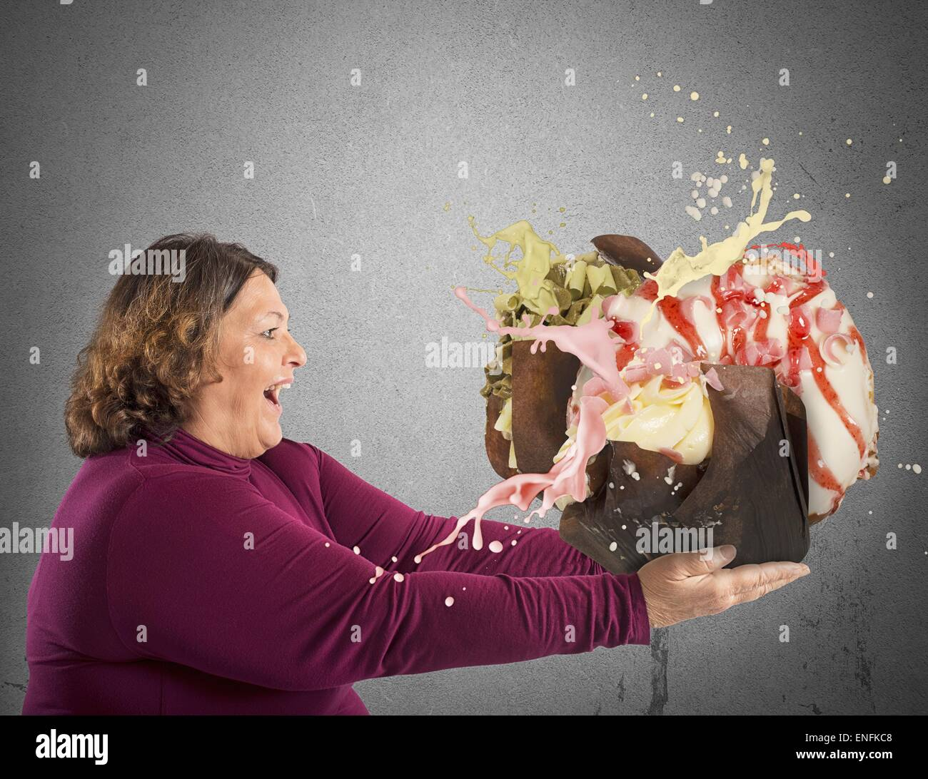 Woman entranced by sweet - Stock Image