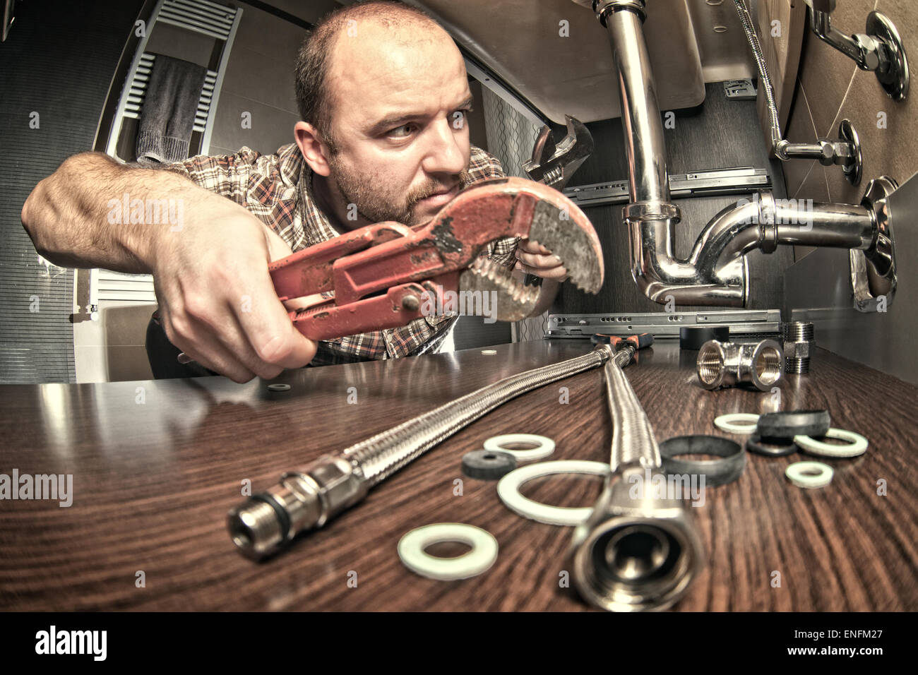 plumber at work indoor shot - Stock Image