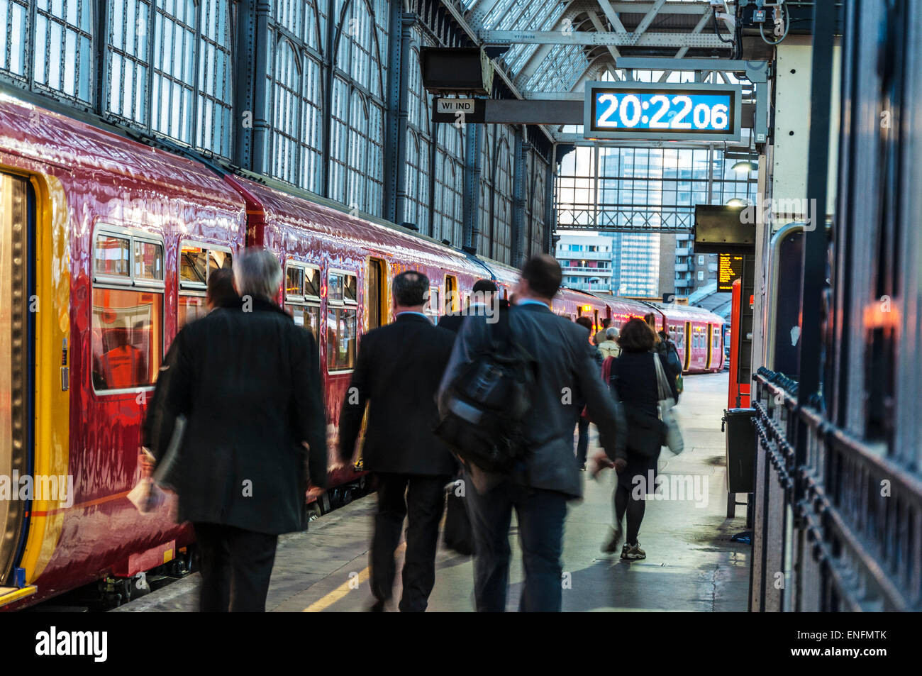 Commuters in motion going home on a train platform from London Waterloo railway station - Stock Image