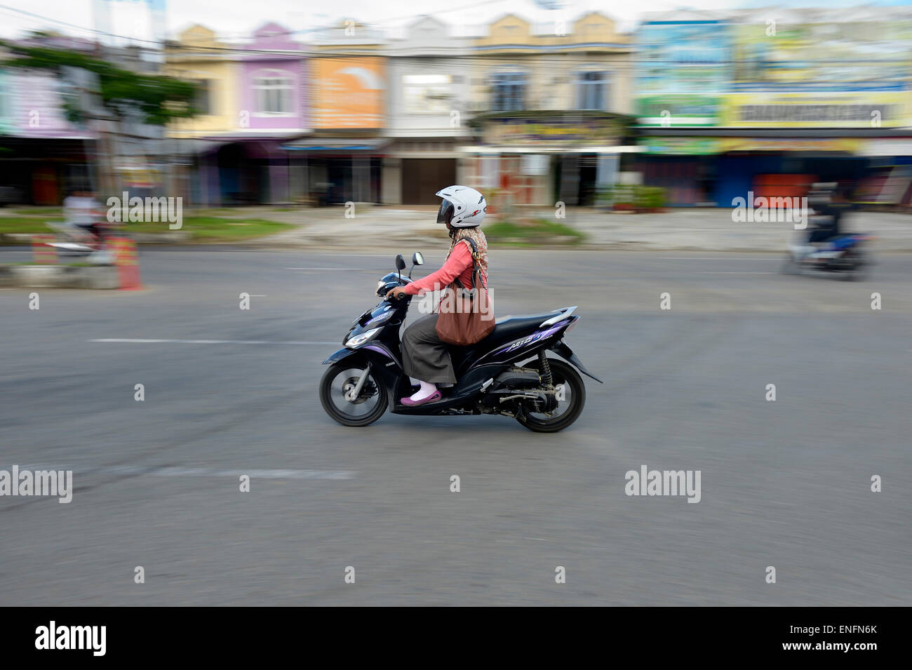 Woman on moped, Banda Aceh, Indonesia Stock Photo