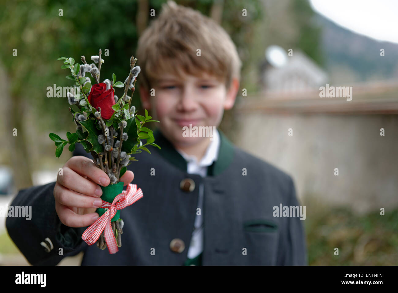 Boy with palm branches, blessing of the palms, Palm Sunday, Holy Week, Easter, Bad Heilbrunn, Upper Bavaria, Bavaria, - Stock Image