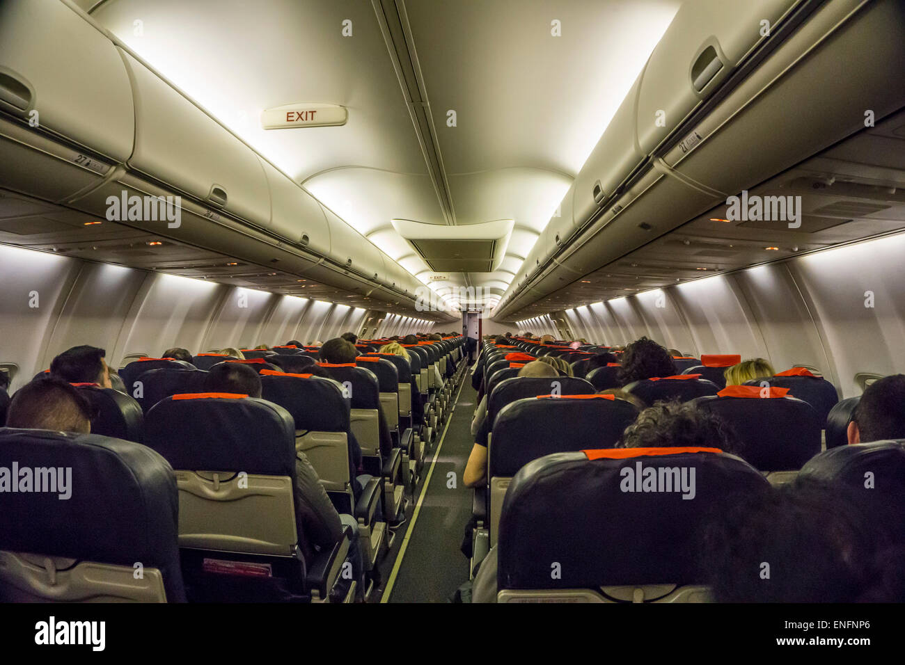 Commercial airliner interior economy class cabin - Stock Image