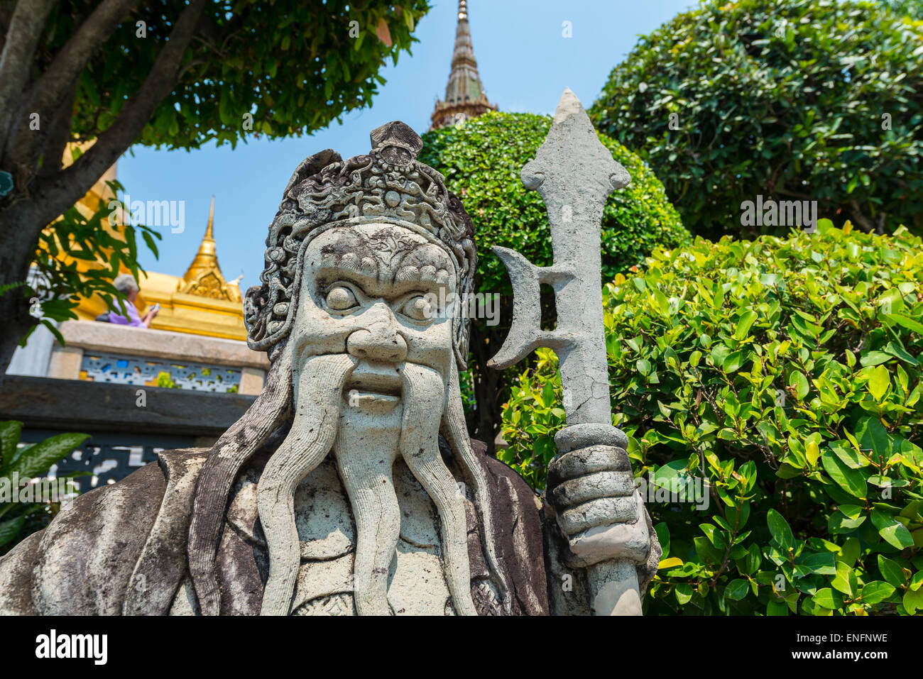 Fearsome stone palace guard, Chinese statue, Royal Palace, Bangkok, Thailand - Stock Image