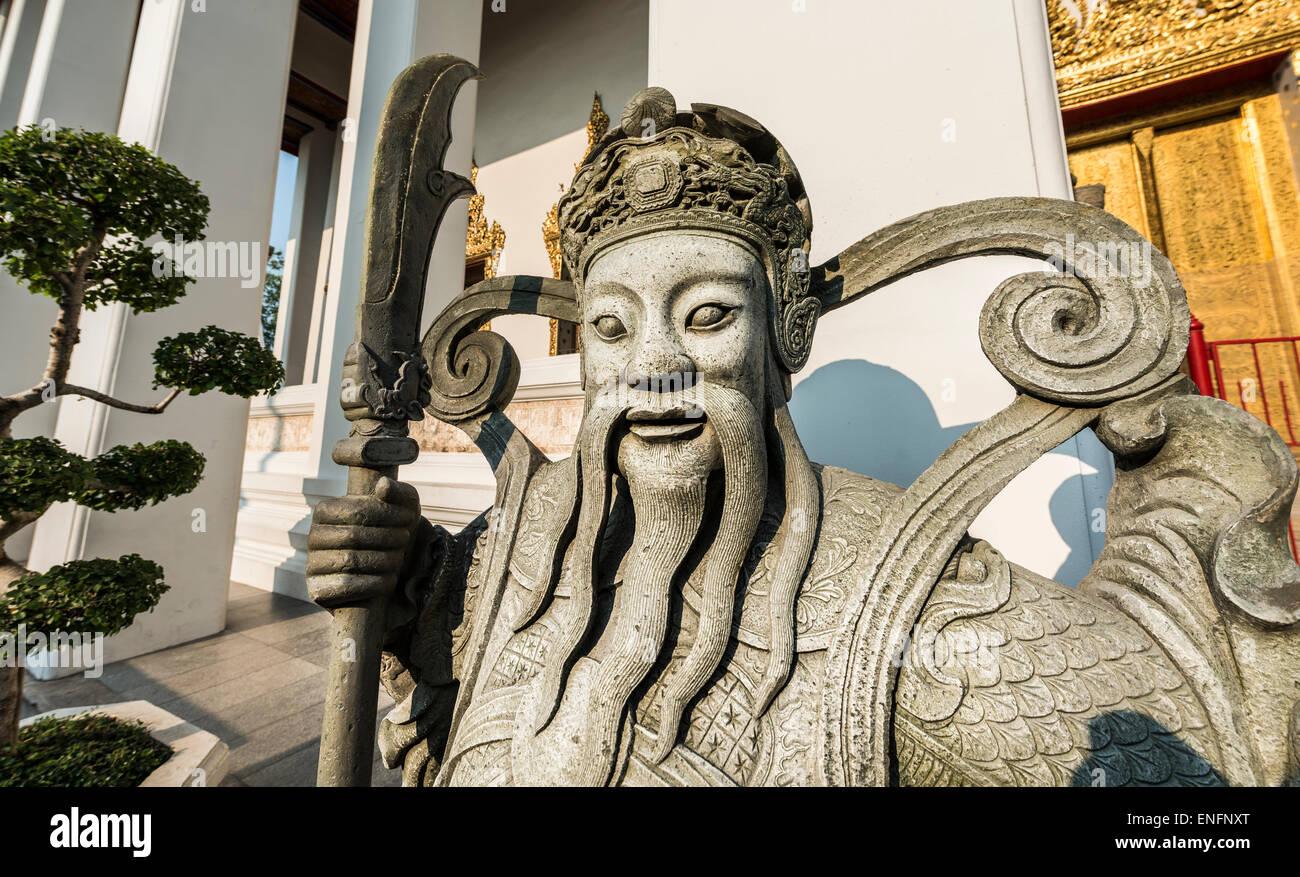 Terrifying Chinese stone statue, guard, Wat Pho, Wat Po, Krung Thep, Bangkok, Thailand - Stock Image