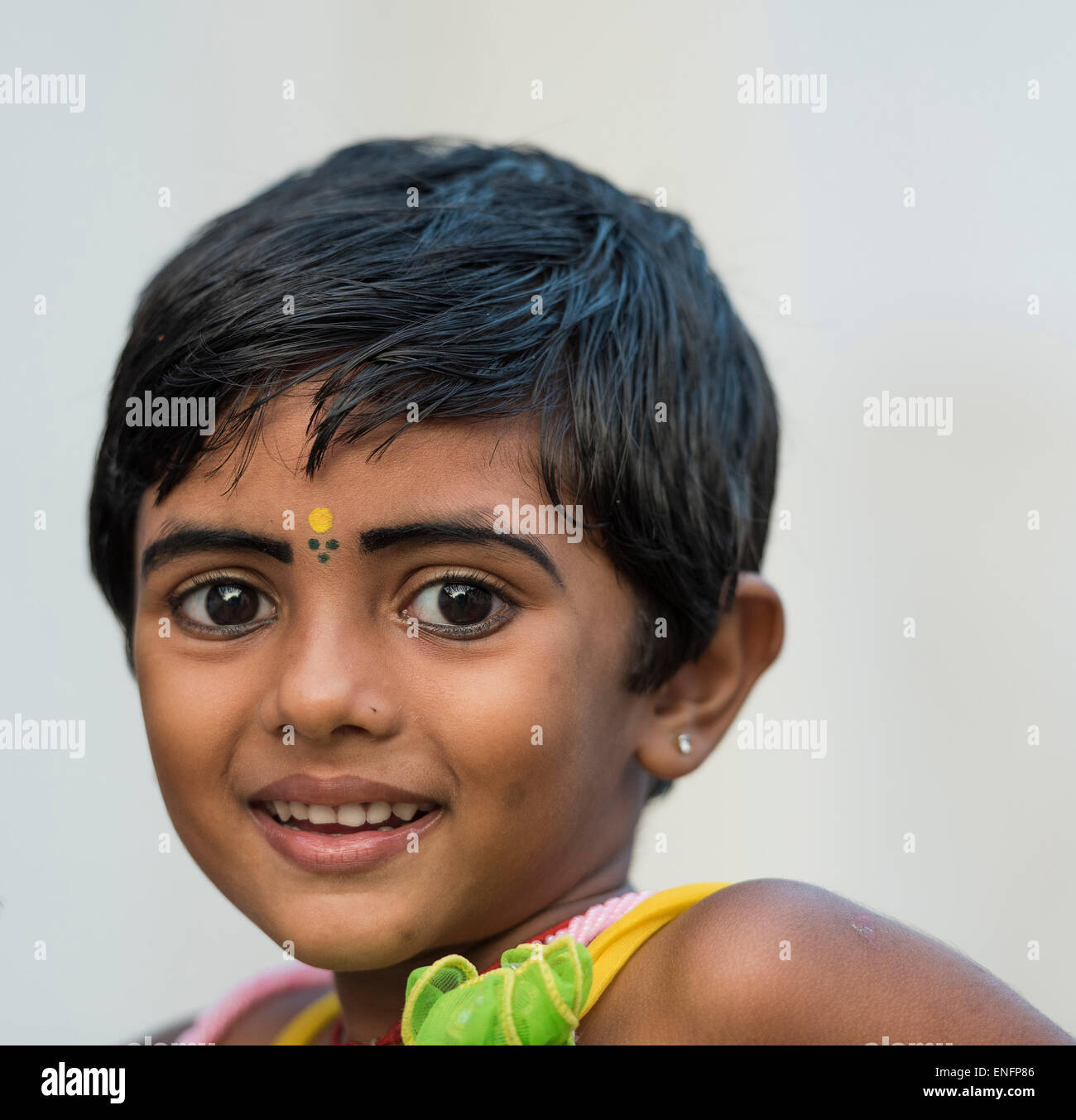 Girl with yellow bindi on the forehead and kohl-rimmed eyes, portrait, Fort Cochin, Kochi, Kerala, India - Stock Image