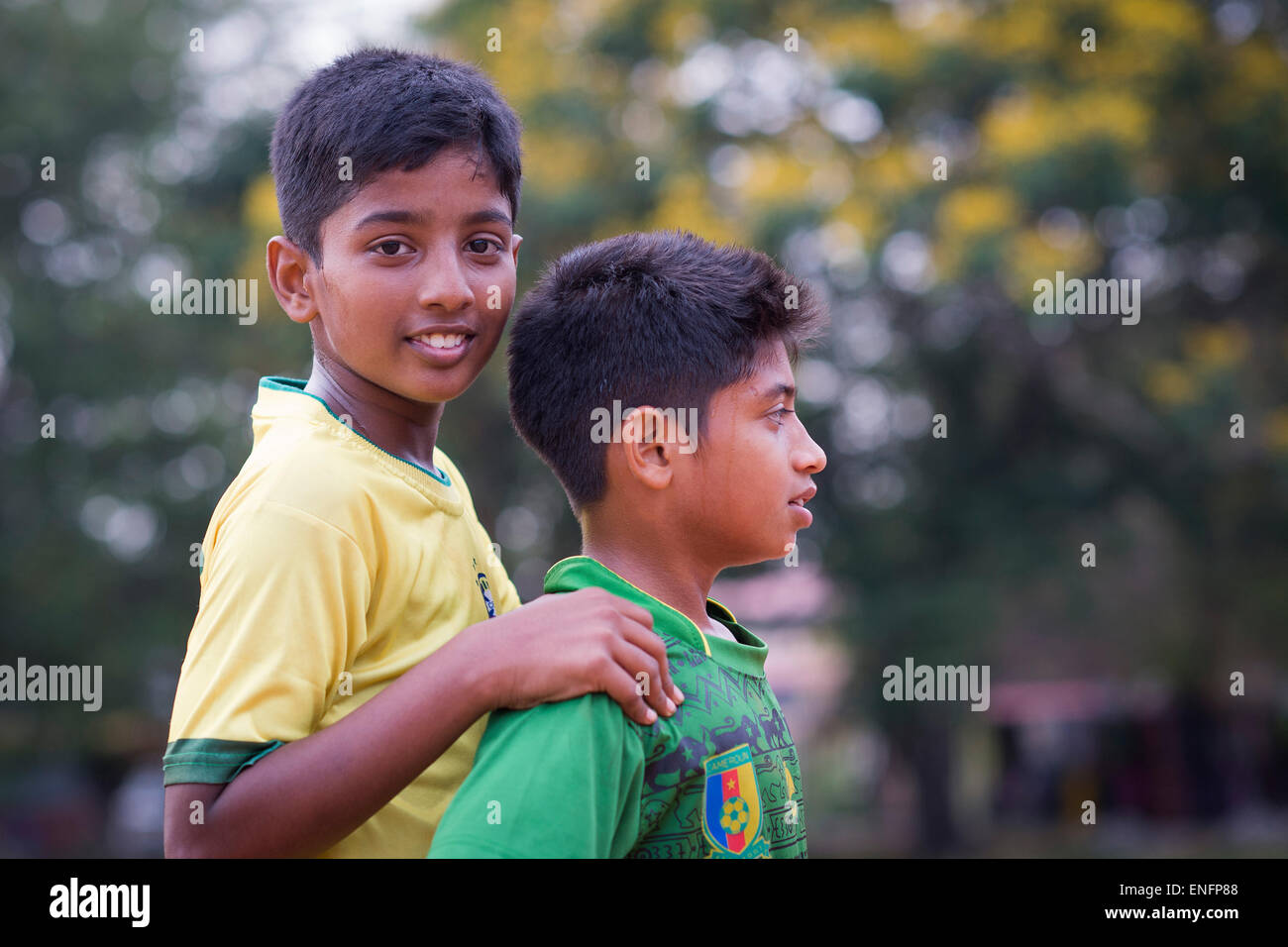 Two boys during a short break at a football game, Parade Ground, Fort Cochin, Kochi, Kerala, India - Stock Image