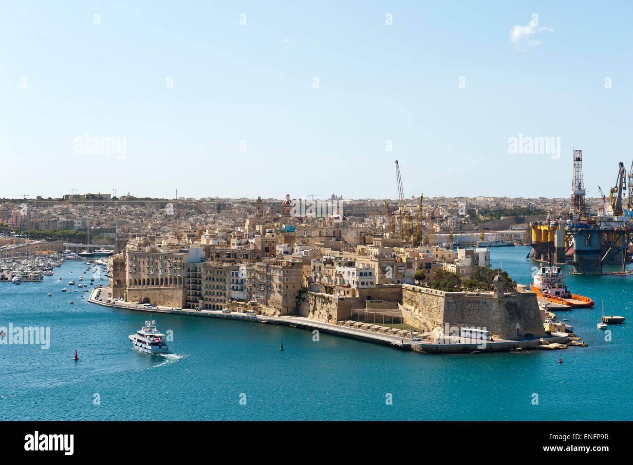 View of the historic centre of Senglea from Valletta, harbor with oil well, Malta - Stock Image