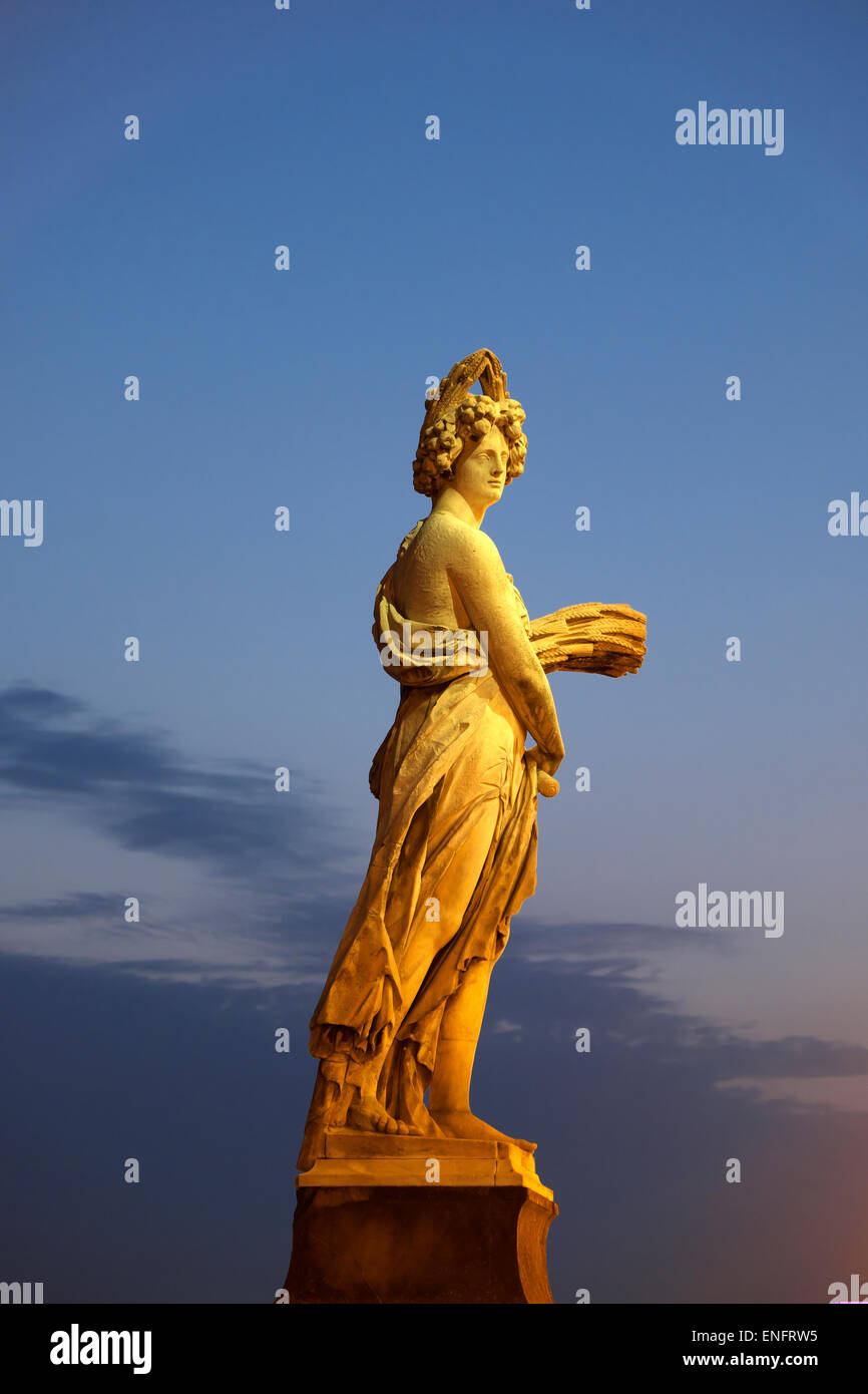 Seasons statue on Ponte Santa Trinita bridge spanning the river Arno, Florence, Tuscany, Italy - Stock Image