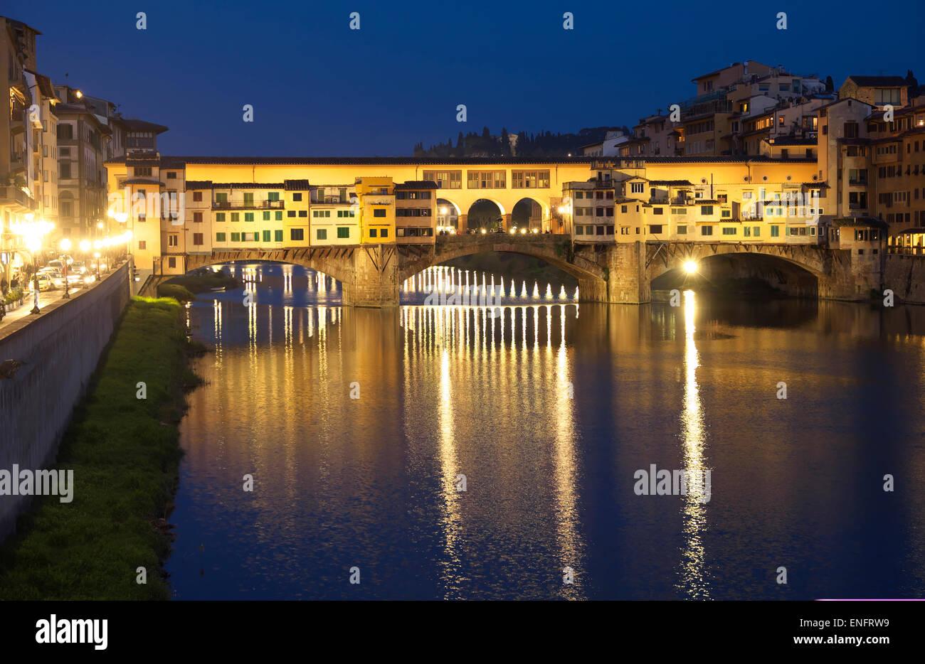 Ponte Vecchio, medieval bridge spanning the Arno River, UNESCO World Heritage Site, Florence, Tuscany, Italy - Stock Image