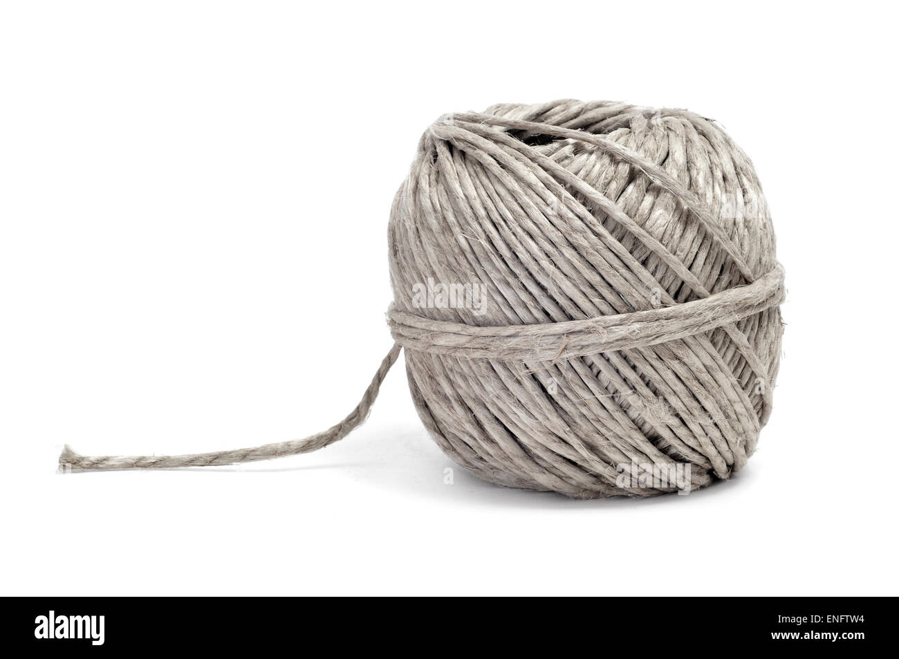 closeup of a coil of hemp twine on a white background - Stock Image