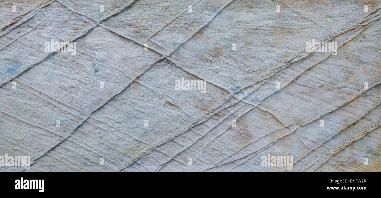 Stone background texture with a cross hatch pattern - Stock Image