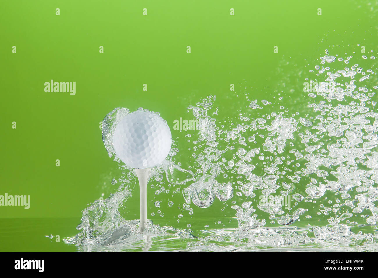Golfball on a peg in water with bubbles - Stock Image