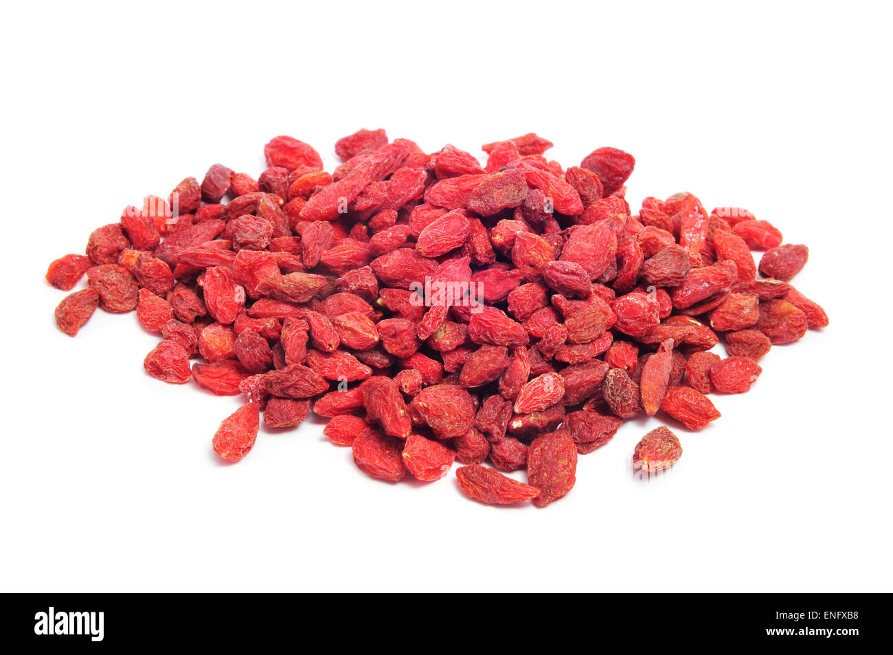 a pile of dried goji berries on a white background - Stock Image