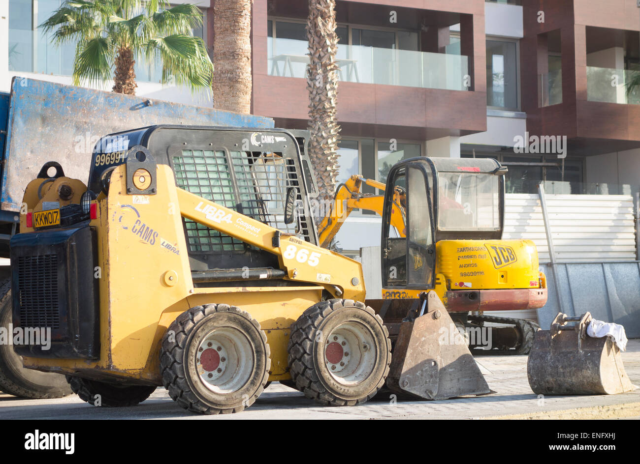 Construction works. Two construction machineries working near new building on the Paphos street. - Stock Image
