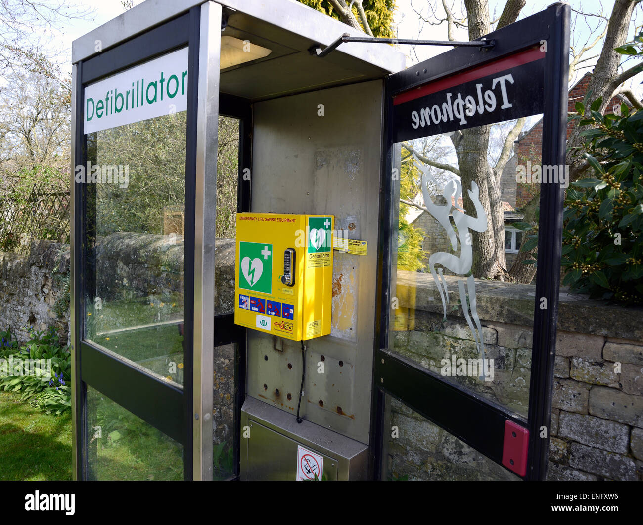 Community phone box converted into a community defibrillator - Stock Image