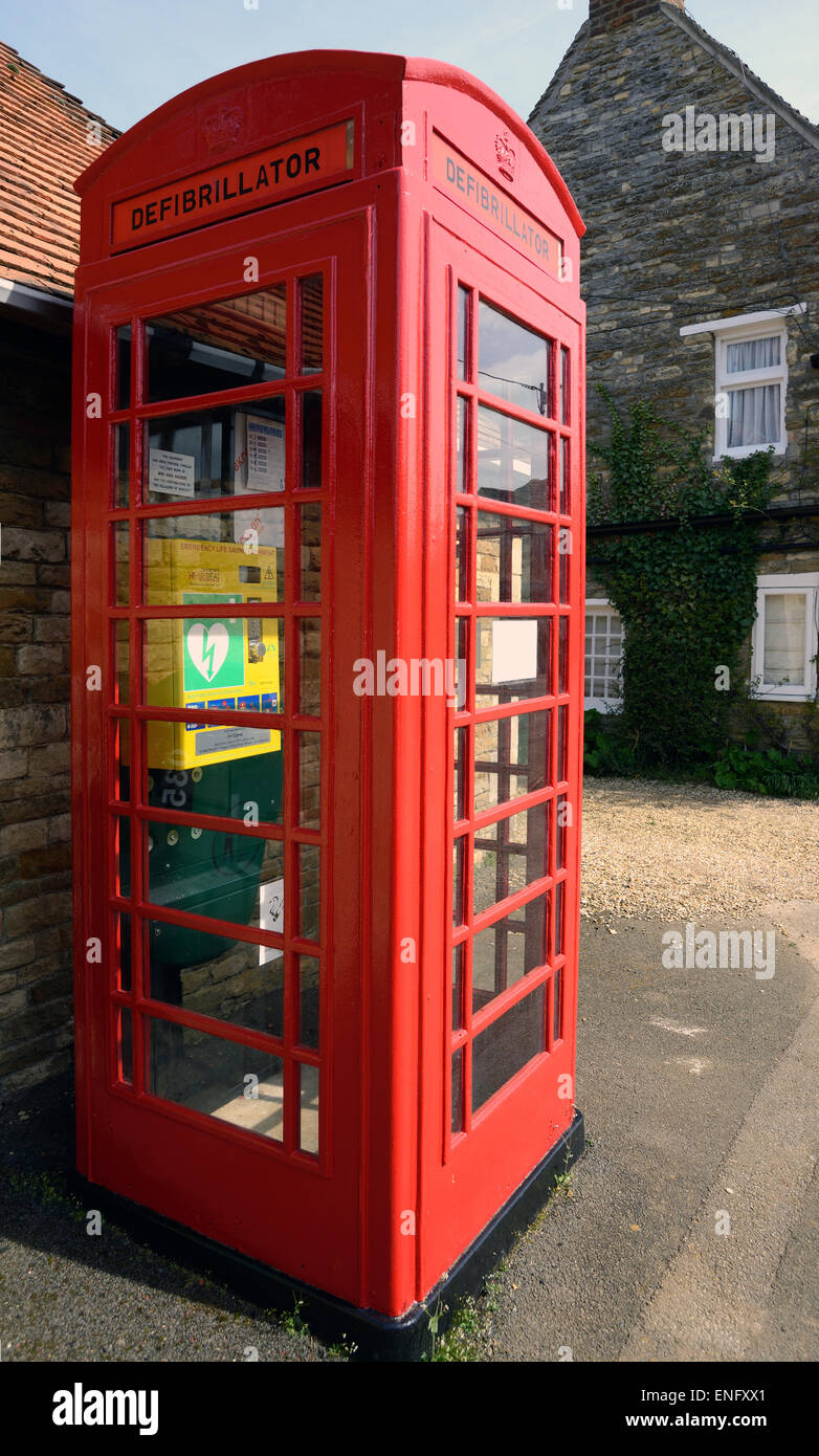 An old telephone box has been converted into a village defibrillator - Stock Image