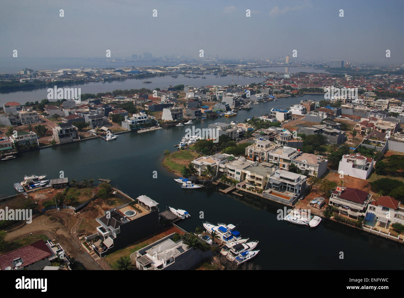 Aerial landscape of Jakarta coastal area, seen from one of the residential towers at Pantai Mutiara in Pluit, Jakarta, Indonesia. Stock Photo