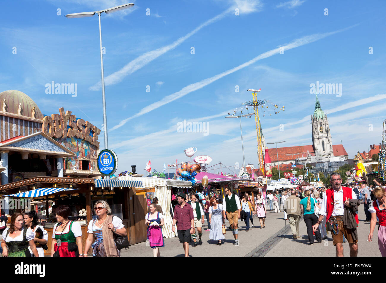 Visitors walk in fine weather on the Wiesn Octoberfest - Stock Image