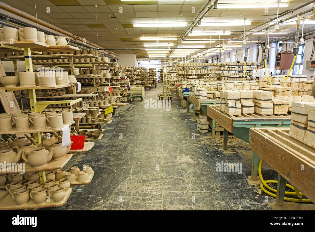 Unfettled (unsmoothed), unglazed and unfired mugs vases and teapots at the Emma Bridgewater pottery factory Stoke - Stock Image