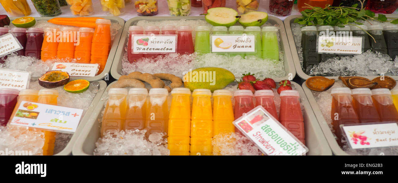 Close up of fresh juices for sale in market - Stock Image