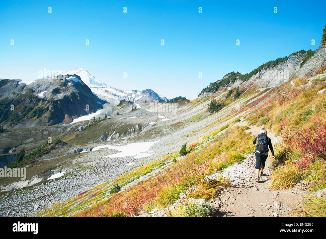 Woman hiking on rocky trail on remote hillside Stock Photo