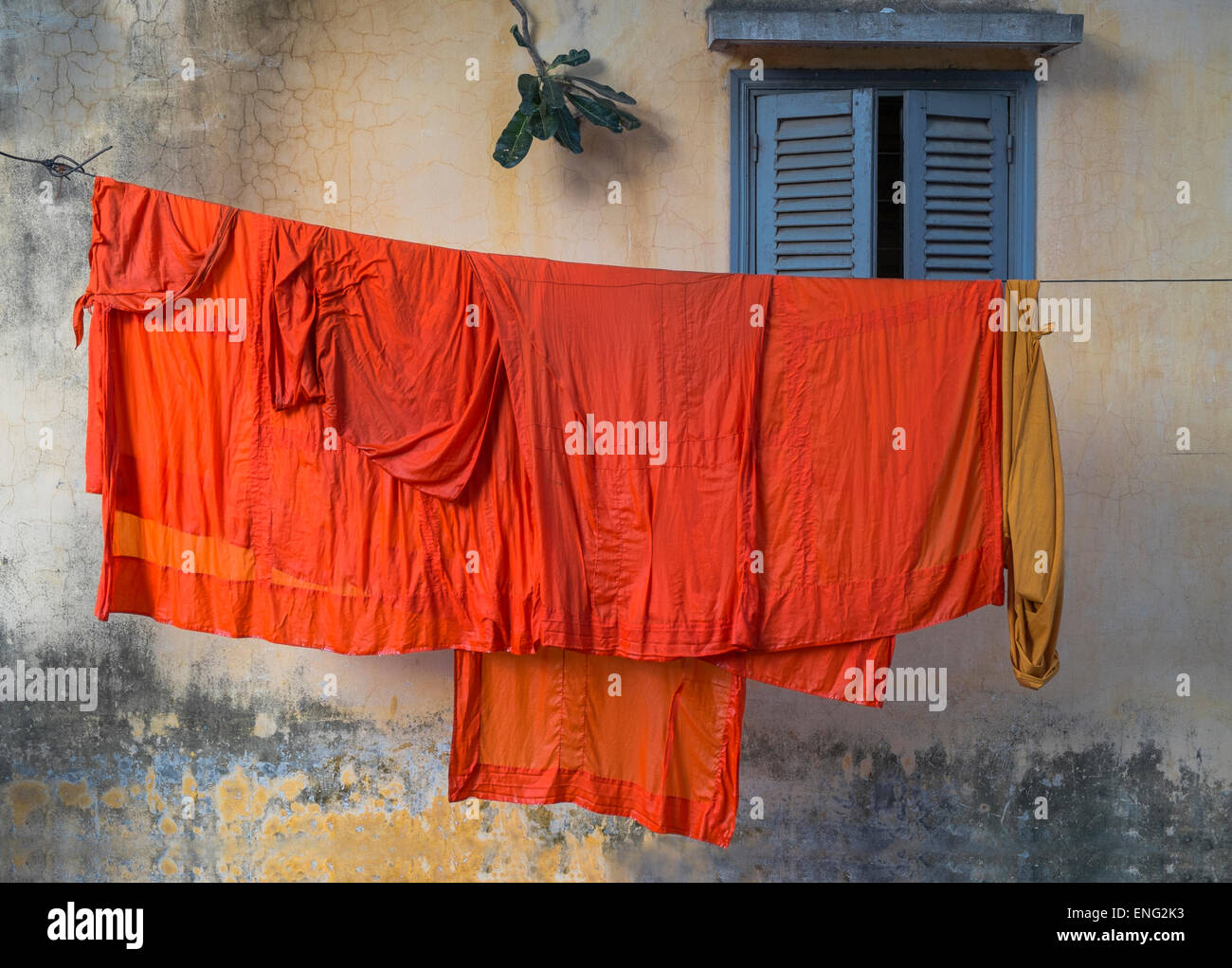 Buddhist monk robes hanging on clothesline - Stock Image