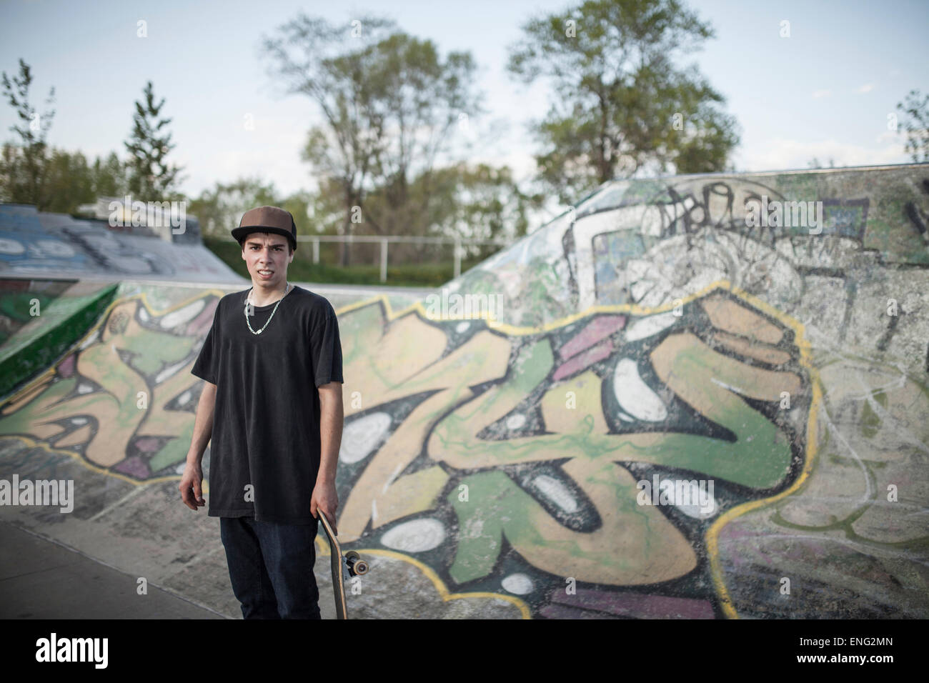 Caucasian man standing at skate park - Stock Image