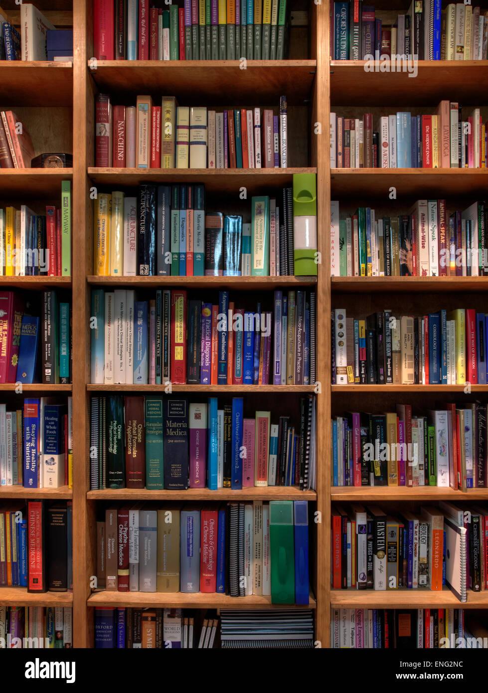 Books organized in bookshelves - Stock Image